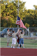 Boy Scouts raising an American flag on the flag pole
