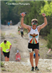 Man with his hands up in victory during the Durty Spur Trail Run