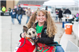 Woman and her dog as Jingles Elf